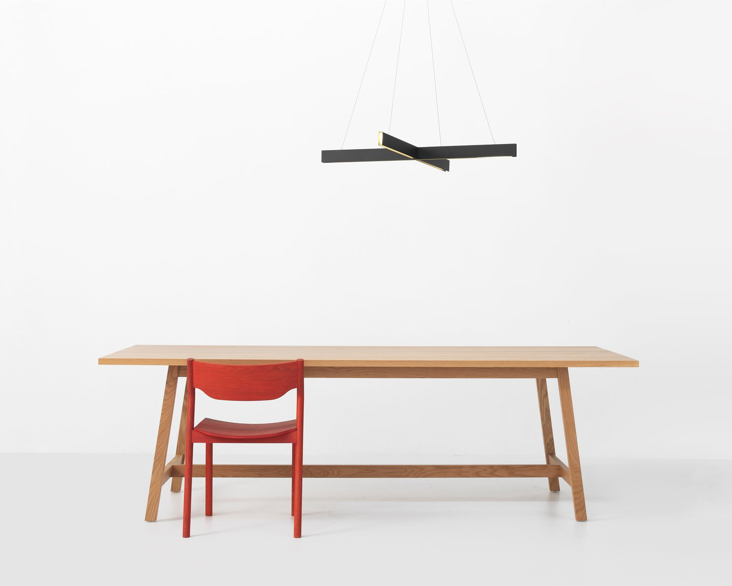 Image: uploads/2017_12/Resident-Cross-pendant---Hawk-table---Tangerine-chair.jpg